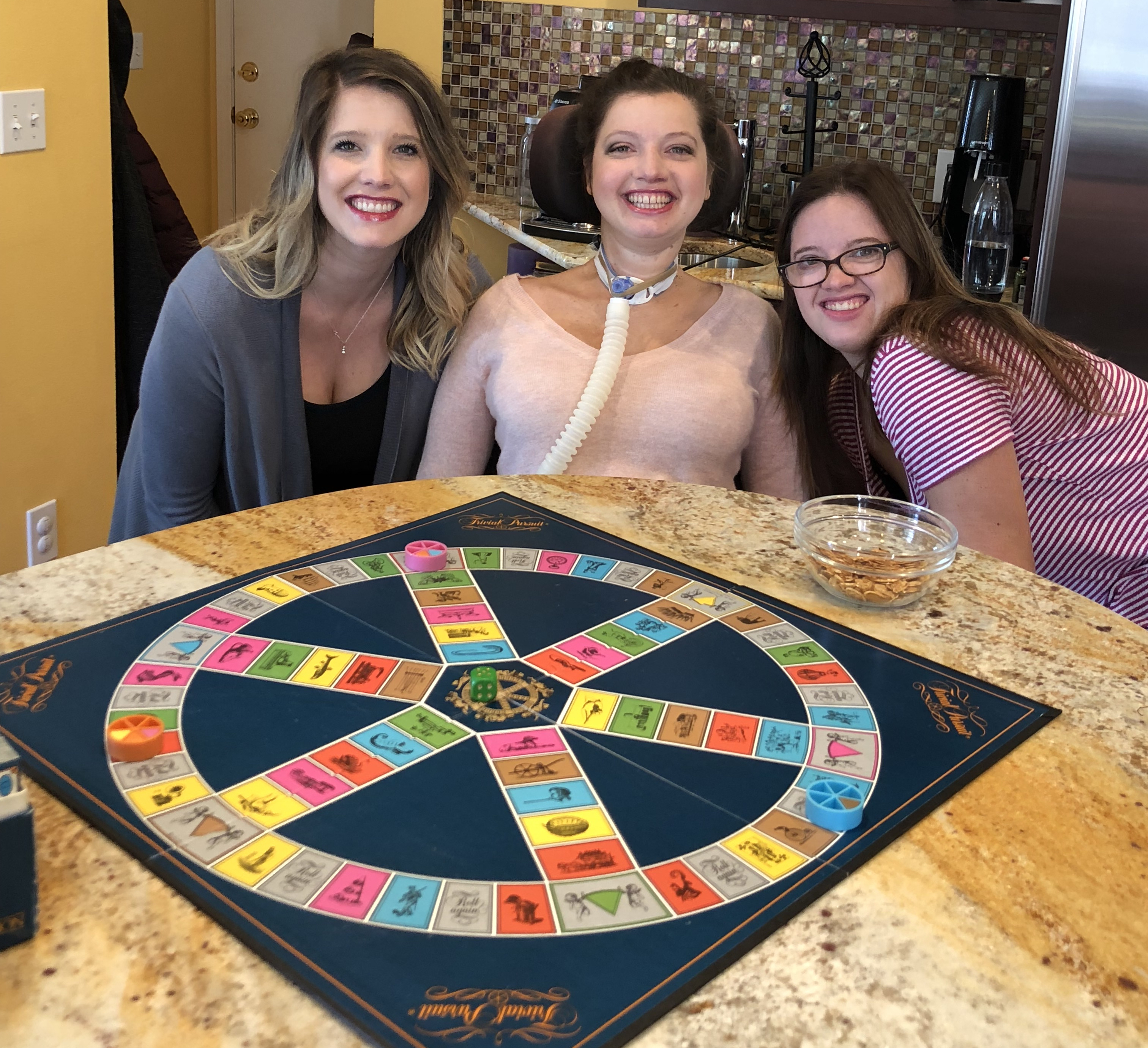Playing Trivial Pursuit with my sisters.  It is a favorite because I love useless knowledge, but it is not quite so useless on family game night!