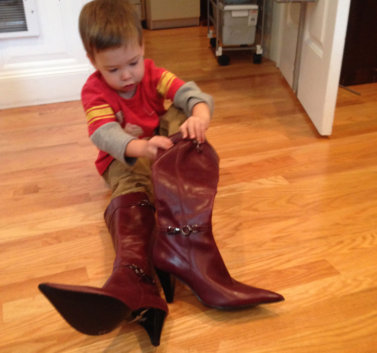 Loa's nephew tries on her boots